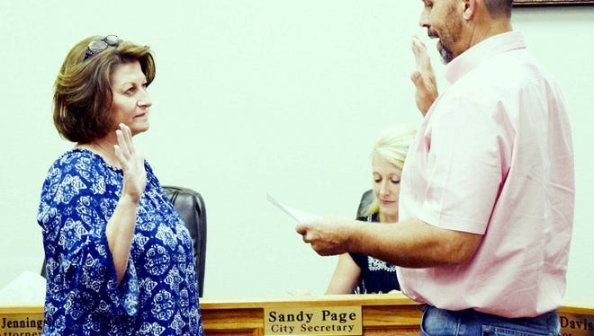 New North Precinct Councilor Gaylynn Burris takes the oath of office to begin her service as a Bowie City Council. She will finish the term of Scott Davis, who was selected to complete former Mayor Larry Slack's term.
