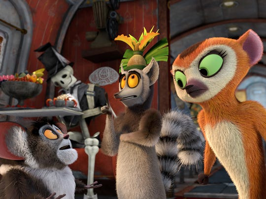 King Julien (center, voiced by Danny Jacobs) ponders