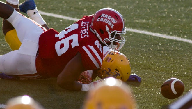 ULs Jarvis Jeffries makes a fumble recovery against McNeese State earlier this season.