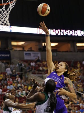 Phoenix center Brittney Griner (right) powers between Seattle forwards Shekinna Stricklen (left) and Crystal Langhorne as the Seattle Storm take on the Phoenix Mercury in the final game of the season at KeyArena in Seattle Sunday.