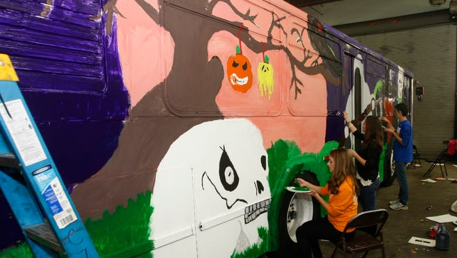 Clarksville Academy works on the annual Spooky Bus Wednesday at Clarksville Transit System.