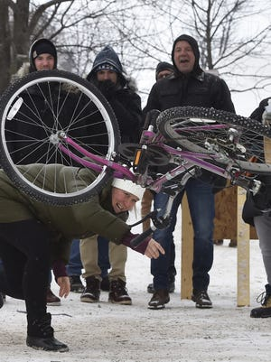 Jen Ostapowich of Oconomowoc gets down as she lets fly while competing in the bicycle toss at a previous Fish Creek Winter Festival.