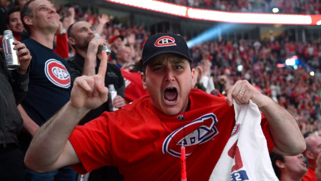 A Montreal Canadiens fan gestures to a camera during a playoff game against the Boston Bruins, May 14, 2014.