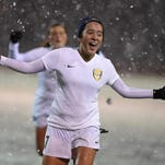 Action photos of the Northern Region Division I girls soccer championship game between Douglas and Bishop Manogue on a snowy Monday night Nov. 10, 2015.