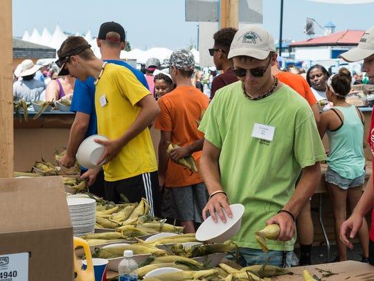 Volunteers serve corn at the J. Millard Tawes Crab