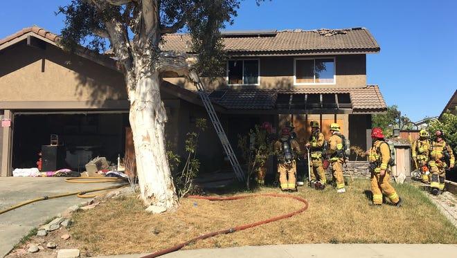 Crews battle a fire Saturday at a home in the 2300 block of Woodpecker Avenue in Ventura.