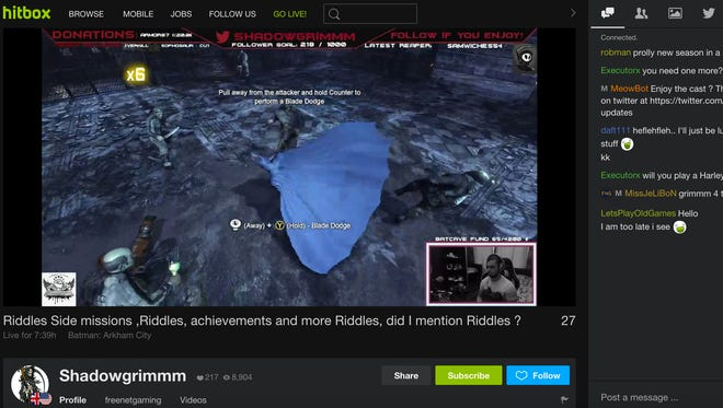 "A screen shot of the Hitbox video-game streaming service showing the game ""Batman: Arkham City."""