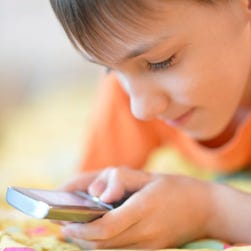 Young boy using mobile phone.