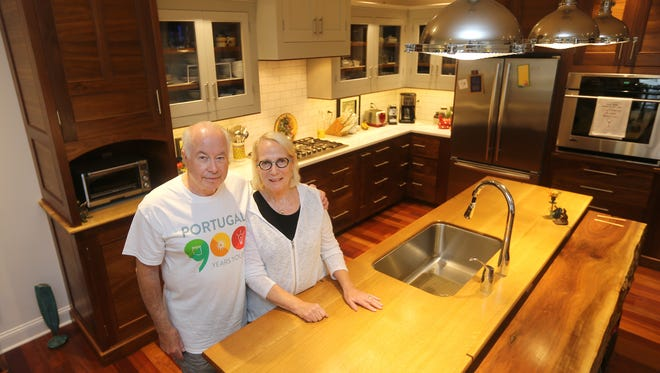 Sandy and Suzanne Mayer in their custom kitchen inside their condominium in the University Avenue/Grove Place neighborhood.