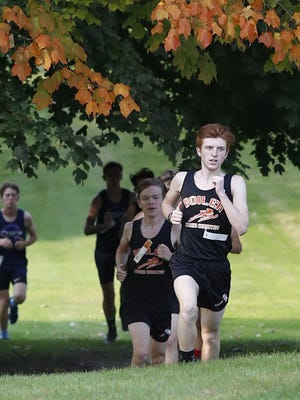 Colin VanStechelman leads the Kewanee boys cross country team through Baker Park. Leaves are turning, a sign the season is headed toward its postseason, which the IHSA voted to extend amid the coronavirus pandemic.