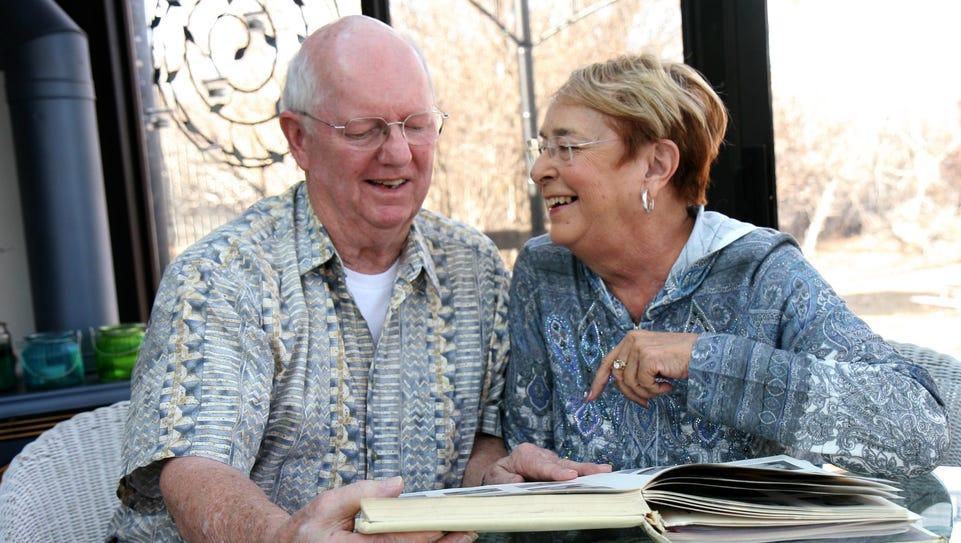 Lyle and Virginia Pinsonneault look through their 1960