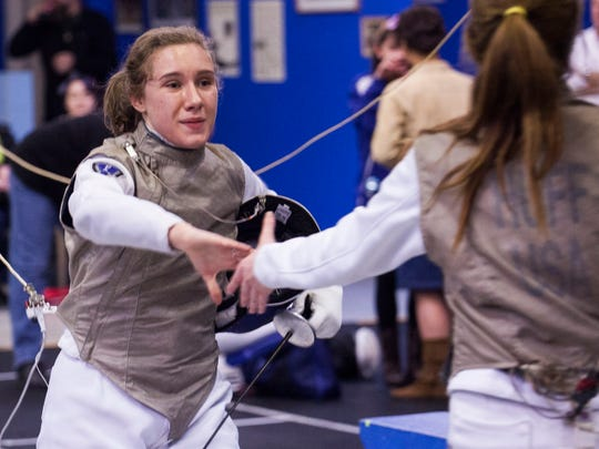 Grayson Katzenbach, left, of Waynesboro is giving fencing lessons in Fishersville, starting in January.