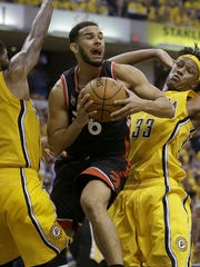 Toronto Raptors guard Cory Joseph (6) drives and passes between Myles Turner (33) and Paul George (13) in the second half of their Eastern Conference first round playoff game Thursday, April 21, 2016, evening at Bankers Life Fieldhouse. The Indiana Pacers lost to the Toronto Raptors 101-85.