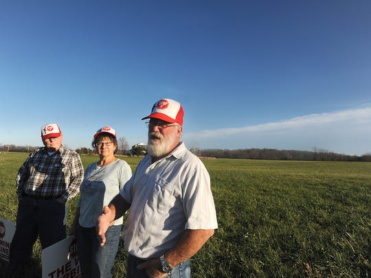 Dennis Alvert and Marcia and Kevin Ledet of Greenwich, Ohio, are unhappy with the environmental effects of a wind turbine farm proposed for their area.