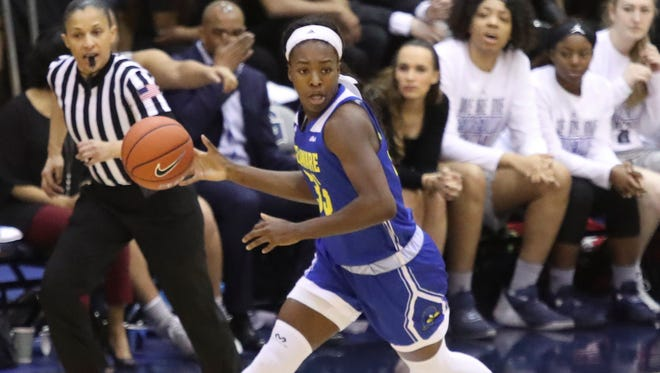 Delaware's Nicole Enabosi pushes the ball up court in the second half of Delaware's 67-57 loss in a first round WNIT game at Georgetown's McDonough Arena Friday.