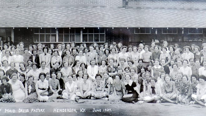 The staff of the Betty Maid Dress Factory is seen here in June 1937.