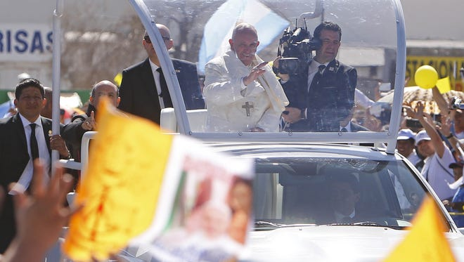 Pope Francis passes by a crowd Wednesday, Feb. 17, 2016, in Juárez, Mexico.