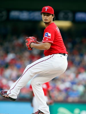 Rangers starting pitcher Yu Darvish pitches in the third inning at Globe Life Park in Arlington.