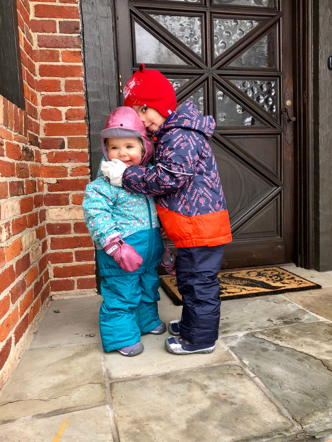 James Crimmins hugs his sister Lily outside of their home.