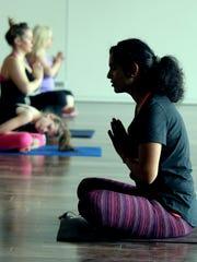 Pooja Malhotra leads a yoga class at the Unity Chapel
