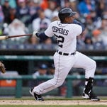 Detroit Tigers' Yoenis Cespedes, right, connects for a grand slam during the first inning of a baseball game against the Chicago White Sox, Sunday, April 19, 2015, in Detroit. (AP Photo/Carlos Osorio)