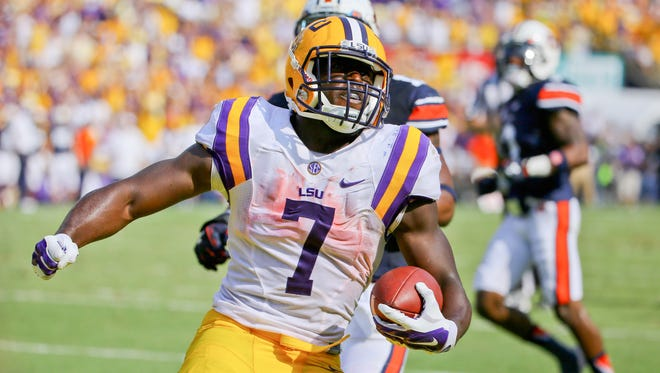 LSU Tigers running back Leonard Fournette (7) celebrates a touchdown against the Auburn Tigers during the second quarter of a game at Tiger Stadium.