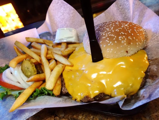 Super deluxe burger with American cheese at Harvey's
