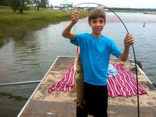 A Cook family photo from the summer of 2014 shows Kaden Cook with a fish he caught up in Sault Ste. Marie.