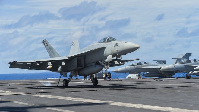 An F/A-18 E/F Super Hornet touches down during a catapult cycle landing aboard the USS Carl Vinson on Feb. 8, 2017.
