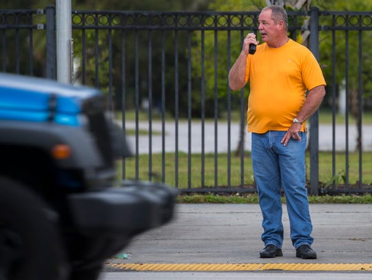 Lee County Sheriff Sgt. Dan Leffin, a member of the traffic unit, waits to cross Palm Beach Boulevard at the intersection with Ortiz Avenue on Tuesday morning, while conducting an undercover operation enforcing pedestrian and bicycle safety. The sheriff's office is conducting a six-month program promoting safer roads for pedestrians, bikers and drivers.