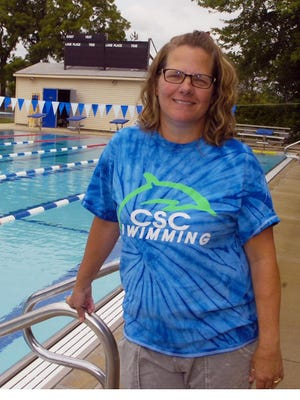 Kristi Moore was involved in the Northwest Suburban Swim League as a swimmer and coach for 41 years. She turned the Cranbrook Swim Club's summer age-group program into one of the area's best in her 22 years as head coach.
