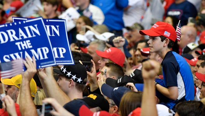 Supporters listen at a rally by President Donald Trump at Municipal Auditorium, Tuesday, May 29, 2018, in Nashville, Tenn.