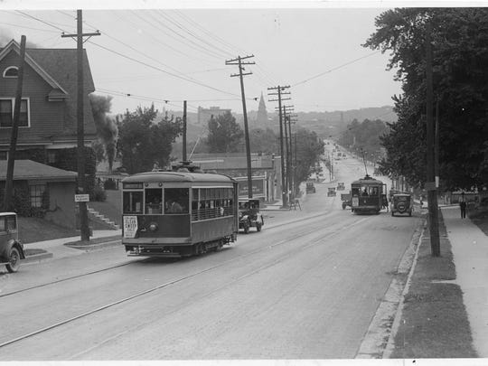 A 1920s photograph shows streetcars traveling along Chauncey Hill in West Lafayette.