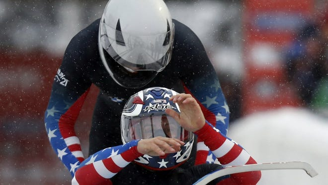 Second-place finishers Nick Cunningham (front) and Dallas Robinson of the United States compete at the IBSF men's two man bobsleigh World Cup at Utah Olympic Park in December.
