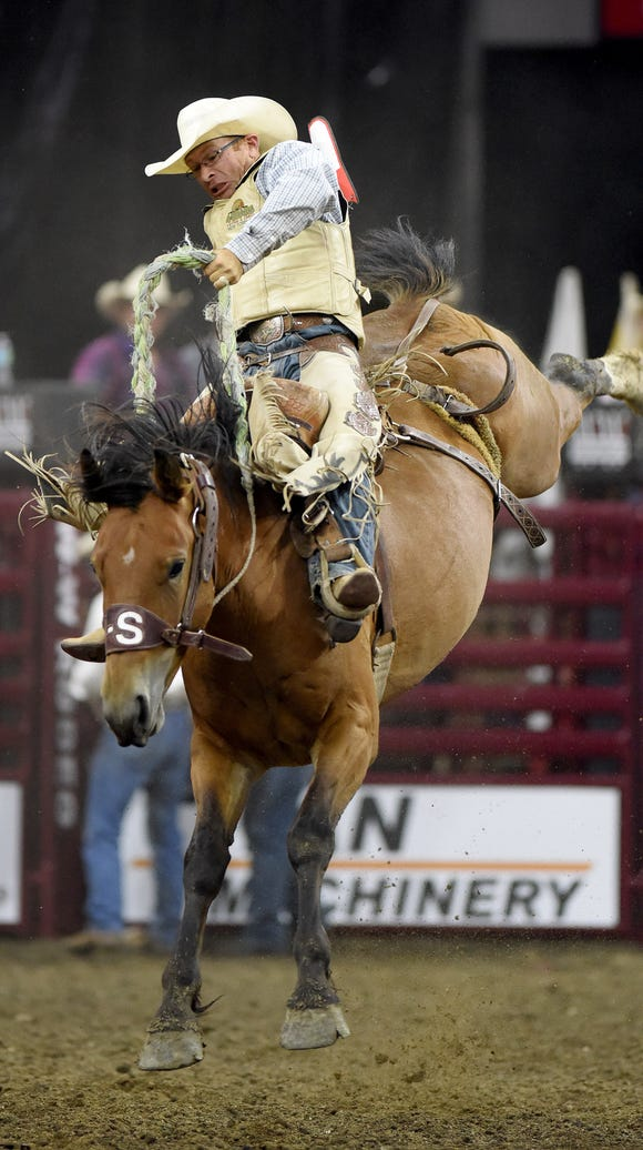 Dusty Hausauer, of ND, rides in the bareback riding
