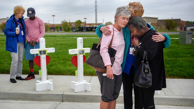 Members of the Billy Graham Rescue Response Team pray with Lancelot DeSilva, far left, Susan Cox and Valerie Aaron at the memorial for the four people that were killed last Sunday at the Waffle House in Antioch, Tenn., Wednesday, April 25, 2018.
