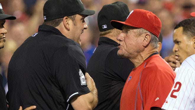 Aug 25, 2015; Philadelphia, PA, USA; Philadelphia Phillies bench coach Larry Bowa (10) is ejected by umpire Dan Bellino (2) after arguing a quick pitch by New York Mets relief pitcher Hansel Robles (not pictured) during the seventh inning at Citizens Bank Park. The Mets won 6-5. Mandatory Credit: Bill Streicher-USA TODAY Sports