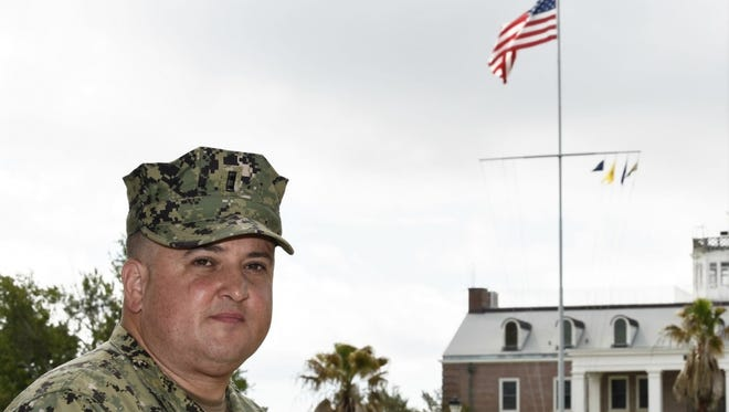 Chief Warrant Officer 4 Kevin Schneider stands outside his office at Corry Station. On April 14, 2018, Schneider saved the life of one of his neighbors in Cantonment.