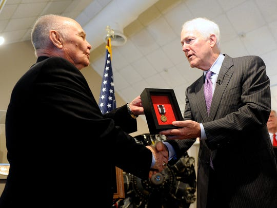 Sen. John Cornyn (right) presents a posthumous Prisoner of War medal to Dr. Stanley Scott for the service of his deceased father, Capt. Stanley Scott during Cornyn's visit to Dyess Air Force Base on Tuesday, April 18, 2017.