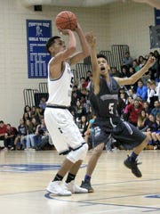 Silver's Jonathan Harris shoots this shot from the top of the key during action against Chaparral on Tuesday night.