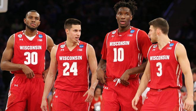Wisconsin seniors Vitto Brown (from left), Bronson Koenig, Nigel Hayes and Zak Showalter are moving on after losing in the Sweet 16.