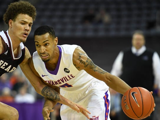 University of Evansville's Ryan Taylor (0) drives against