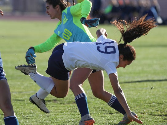 Kenia Verduzco dribbles collides with the keeper during
