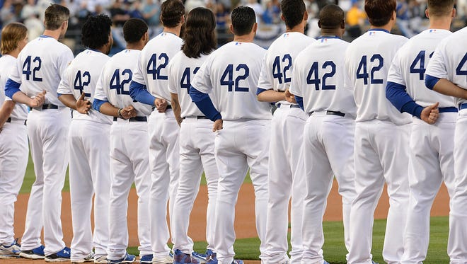 Friday, every player in Major League Baseball will wear Jackie Robinson's retired number 42.
