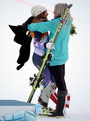Julia Mancuso celebrates with her sister Sara Mancuso after winning the bronze medal in super combined.