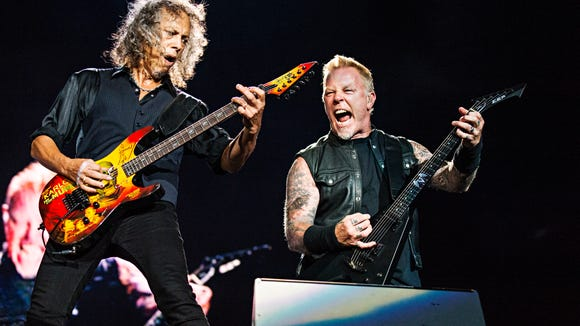 Kirk Hammett, left, and James Hetfield of Metallica perform during the Festival d'ete de Quebec on Friday July 14, 2017, in Quebec City, Canada. (Photo by Amy Harris/Invision/AP)