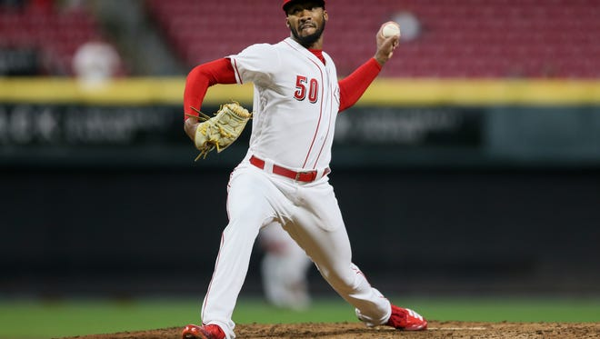 Cincinnati Reds relief pitcher Amir Garrett (50) delivers in the ninth inning during the National League baseball game between the Atlanta Braves and the Cincinnati Reds, Tuesday, April 24, 2018, at Great American Ball Park in Cincinnati.
