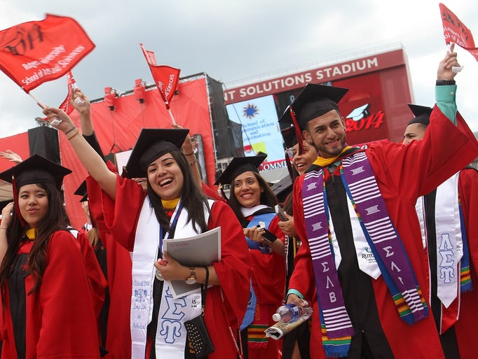 Graduates enter High Point Solutions Stadium at the start of Rutgers University's 248th commencement, Sunday, May 18, 2014, in Piscataway, NJ.  Photo by Jason Towlen