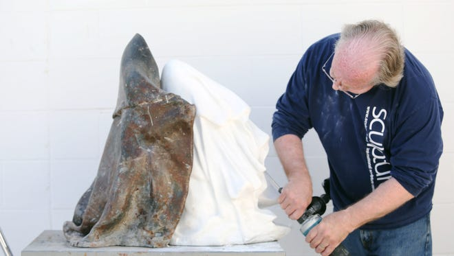 """Sculptor Patrick Blythe works on his stone piece called """"Reconciliation"""" at the Coachella Valley Art Center on Tuesday, March 1 19, 2016 in Indio, Calif."""