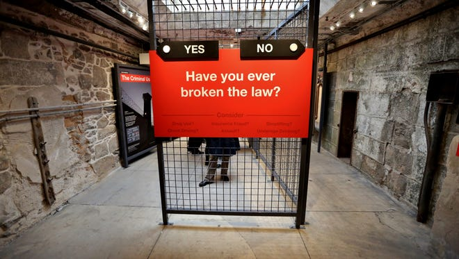 Guests to Eastern State Penitentiary's 'Prisons Today' exhibit are asked some thought-provoking questions as they tour the installation examining mass incarceration.